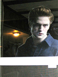 Guests are greeted by the pale and sullen visage of an Edward Cullen cut-out glowering from the window.