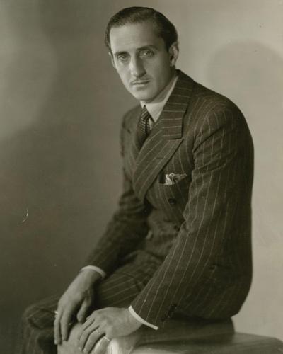 Photograph of Basil Rathbone by George Hurrell from 1937. Rathbone's most famous character was Sherlock Holmes which he would debut in 1939 in The Hound of Baskervilles