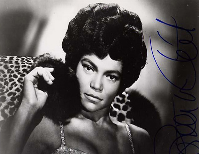 Signed photograph of Eartha Kitt striking a sultry pose