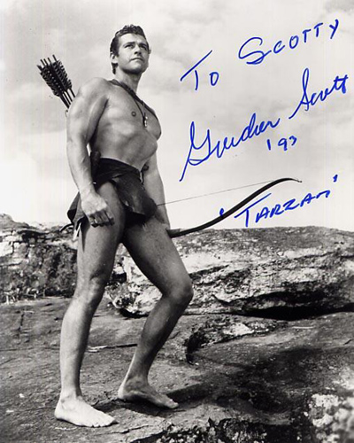 Reprint still of Gordon Scott posing as Tarzan which he played in six different movies, beginning in 1955.