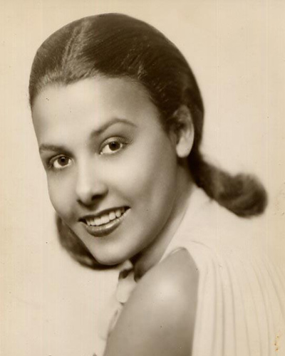 Portrait of a very young Lena Horne, taken at the start of her legendary career. Photographer stamp of Herbert Mitchell on the back.