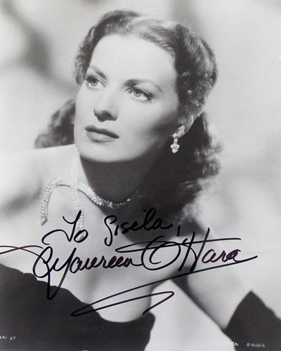 8 x 10 black-and-white photo portrait of Hollywood icon Maureen O'Hara which she has signed and inscribed in bold black marker.