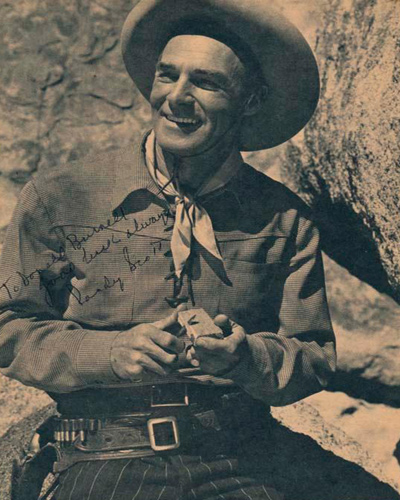 Signed photograph of Randolph Scott who appeared in dozens of shoot-em ups during his long film career.