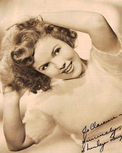 Autographed photograph, ca. 1945. 6.5x5 Shirley Temple (b. 1928), about age 16-17, around the time of her first marriage to John George Agar.