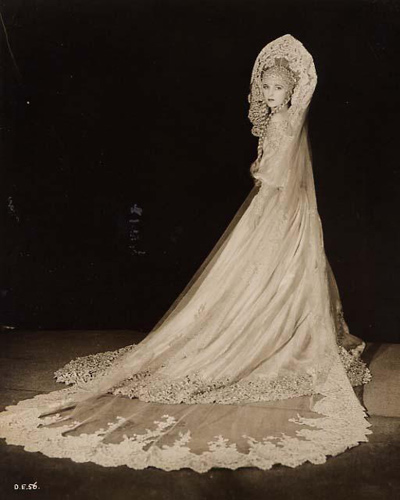Beautiful rare original 8 x 10 publicity portrait of a Hollywood starlet in a very elaborate wedding gown. The still is not credited but it looks to be from an early sound musical.