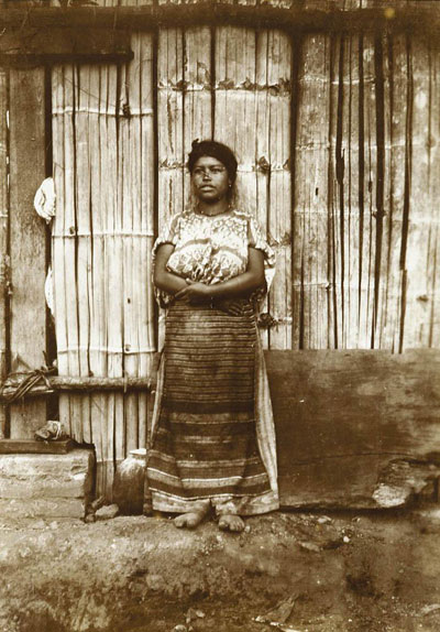 This vintage aristotype shows a young woman from the Andes in 1880.