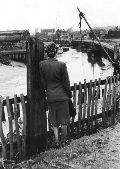 In 1940, a woman looks out over the industrial estuary.