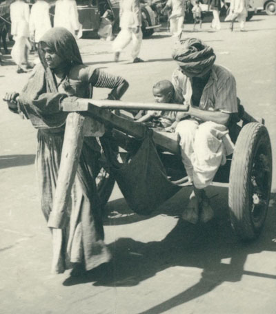 An Indian woman pulls a cart in 1949.