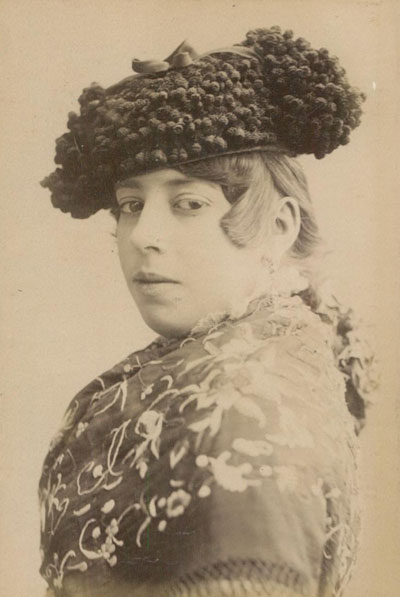 A Spanish woman poses with a matador hat in 1880.