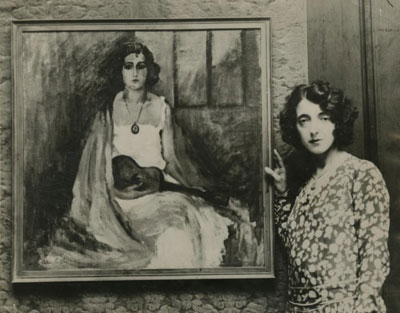 Circa 1940, portrait painter Elisa Sullo poses with her work.